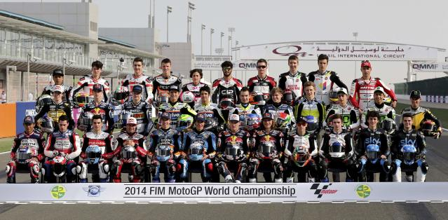 Moto3 riders pose for a group photo before the start of the free practice session of the MotoGP World Championship at the Losail International circuit in Doha March 20, 2014. REUTERS/Fadi Al-Assaad (QATAR - Tags: SPORT MOTORSPORT)