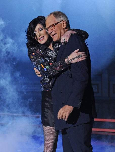 "FILE - In this Sept. 24, 2013 file photo provided by CBS, Cher embraces host David Letterman after she performed a song off her new album, on ""Late Show with David Letterman,"" in New York. During a taping of his show Thursday, April 3, 2014, Letterman said he has informed his CBS bosses that he will step down in 2015, when his current contract expires. He told his audience he expects his departure will be ""at least a year or so"" from now. (AP Photo/CBS, Jeffrey R. Staab) MANDATORY CREDIT; NO SALES; NO ARCHIVE; FOR NORTH AMERICAN USE ONLY)"