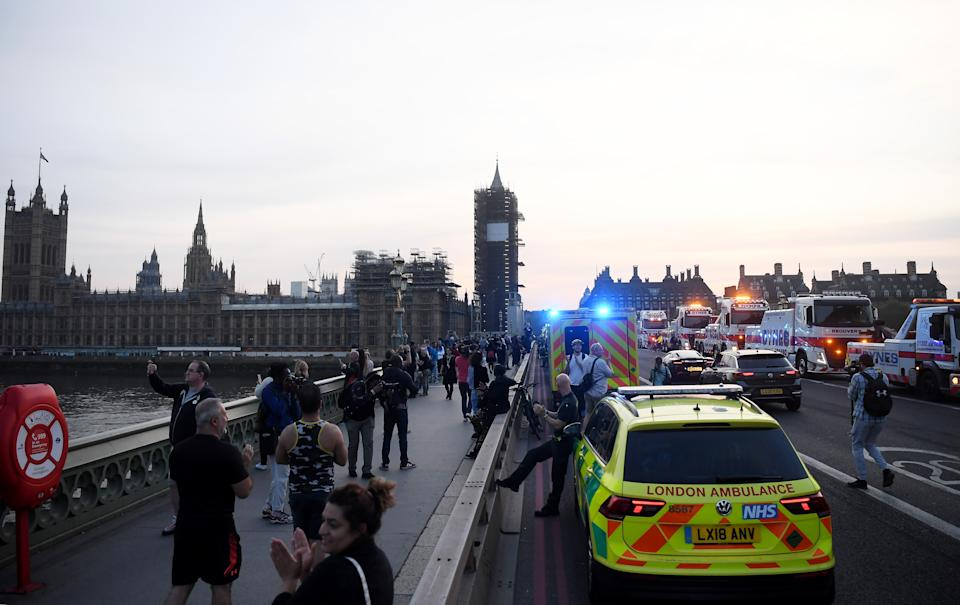 """LONDON,ENGLAND  - APRIL 23: Members of the public and Emergency Services gather on Westminster Bridge on April 23, 2020 in London, United Kingdom. Following the success of  the """"Clap for Our Carers"""" campaign, members of the public are being encouraged to applaud NHS staff and other key workers from their homes at 8pm every Thursday. The Coronavirus (COVID-19) pandemic has infected over 2.5 million people across the world, claiming at least 18,738 lives in the U.K. (Photo by Alex Davidson/Getty Images)"""