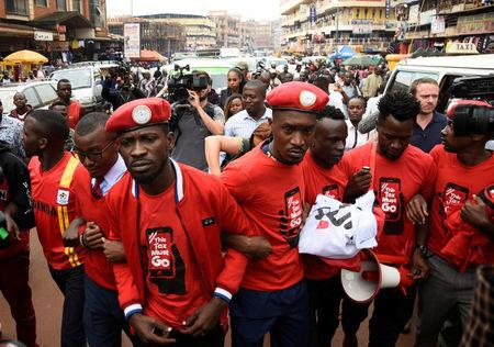 Ugandan musician turned politician, Robert Kyagulanyi, leads activists during a demonstration against new taxes including a levy on access to social media platforms in Kampala, Uganda July 11, 2018. REUTERS/Newton Nambwaya