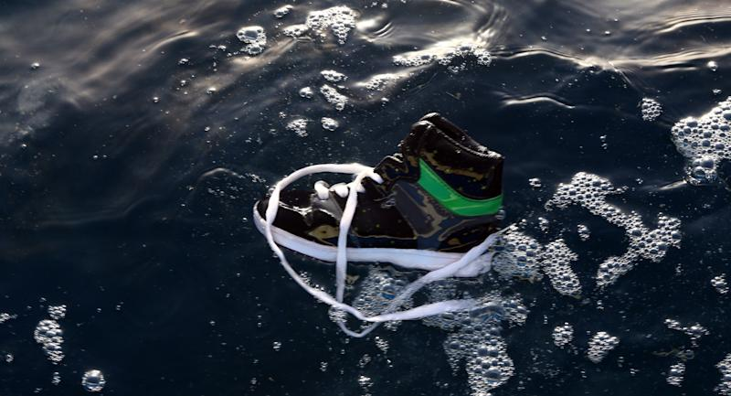 A shoe belonging to an illegal immigrant floats on the water after a boat carrying 200 illegal migrants from sub-Saharan Africa sank off the shores of al-Qarbole, Libya, on August 22, 2014
