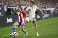U.S. forward Carli Lloyd, right, and Paraguay forward Ramona Martinez (18) vie for the ball during the second half of an international friendly soccer match Thursday, Sept. 16, 2021, in Cleveland. The U.S. team won 9-0. (AP Photo/Tony Dejak)
