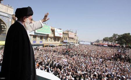 Iran's Supreme Leader Ayatollah Ali Khamenei waves to the crowd in the holy city of Qom, south of Tehran