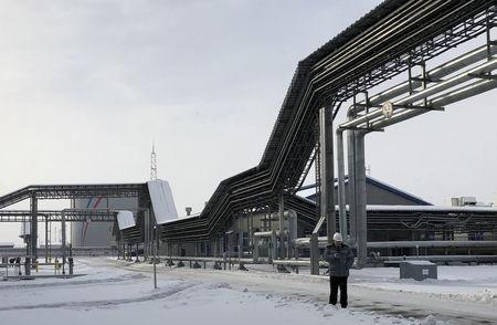 FILE PHOTO: An oil storage tank of Russian oil pipeline monopoly Transneft is pictured at the Baltic Sea port of Ust-Luga
