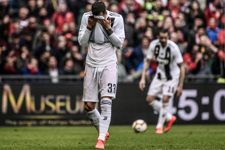 Juventus forward Federico Bernardeschi reacts after his side's first Serie A defeat of the season to Genoa