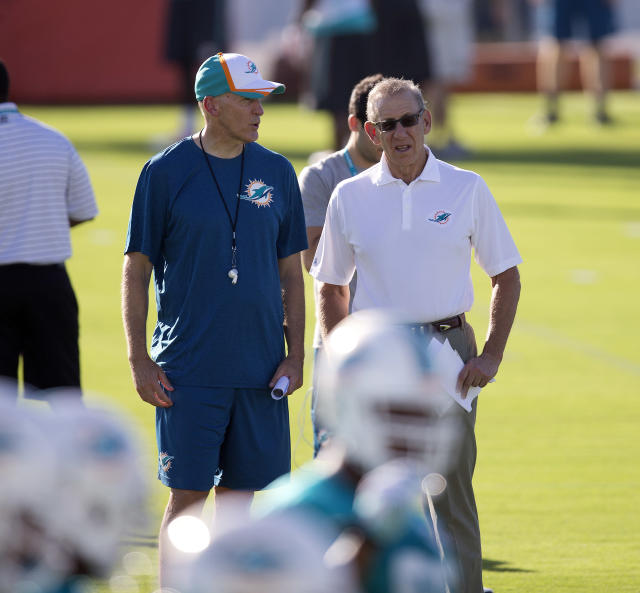 Miami Dolphins coach Joe Philbin, left, and owner Stephen Ross talk during NFL football training camp Friday, July 25, 2014, in Davie, Fla. (AP Photo)