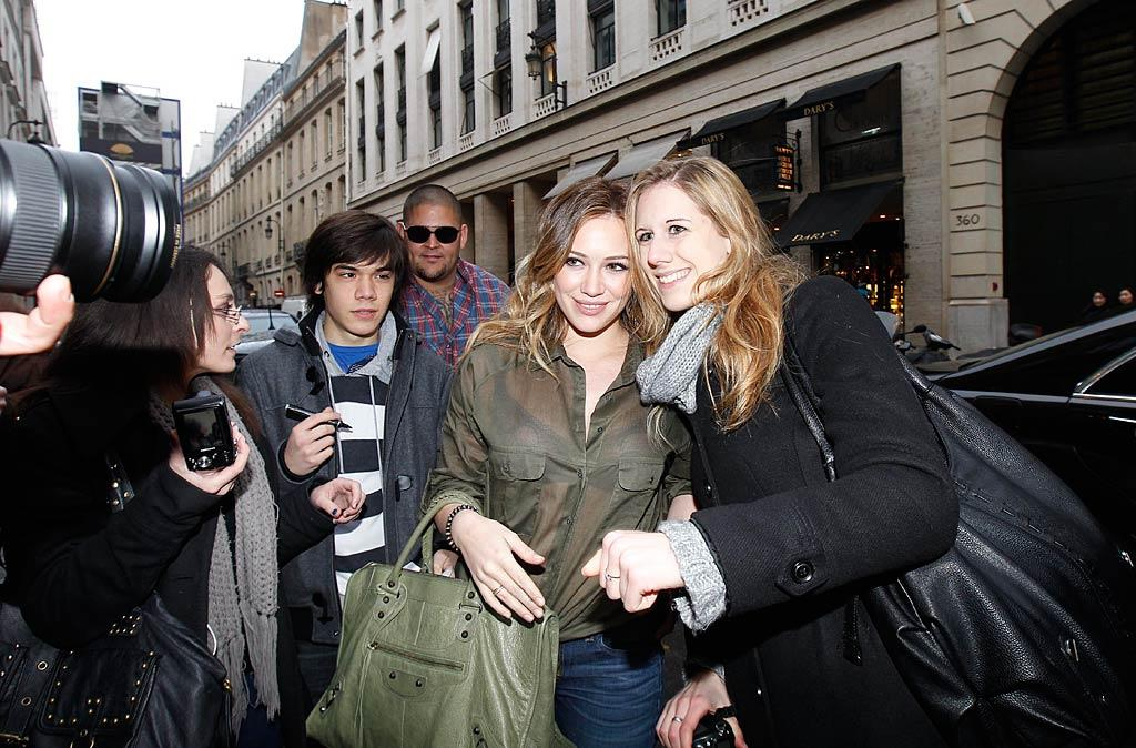 "Even with a crew of Parisian photographers following her around, the star was having a great time in the City of Light. ""French paps! Lol. They are actually very friendly here,"" tweeted Duff with good humor. KCSPresse/<a href=""http://www.splashnewsonline.com"" target=""new"">Splash News</a> - January 1, 2011 - February 3, 2011"