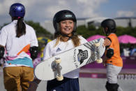 Sky Brown of Britain, center, walks away after chatting with Sakura Yosozumi of Japan, left, and Misugu Okamoto of Japan, right, as they take part in a women's park skateboarding practice session at the 2020 Summer Olympics, Monday, Aug. 2, 2021, in Tokyo, Japan. (AP Photo/Ben Curtis)