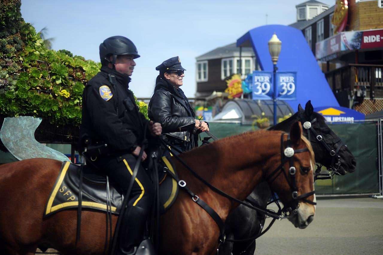 SAN FRANCISCO, CA, USA - MARCH 18: Mounted officers patrol the area outside Pier 39 in San Francisco on day one of the shelter in place order on March 18, 2020. (Photo by Neal Waters/Anadolu Agency via Getty Images)