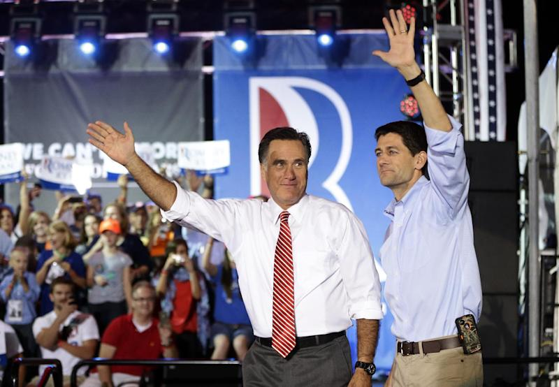 Republican presidential candidate and former Massachusetts Gov. Mitt Romney campaigns with his running mate Rep. Paul Ryan, R-Wis., in Fishersville, Va., Thursday, Oct. 4, 2012. (AP Photo/Charles Dharapak)