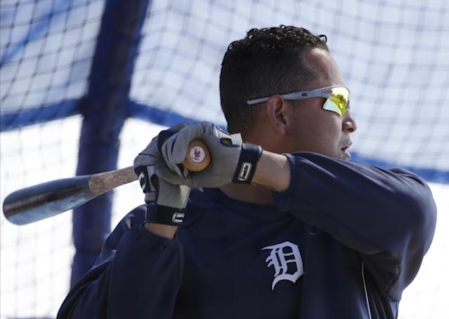 Detroit Tigers Miguel Cabrera bats in the cage before a spring training baseball game against the Toronto Blue Jays in Dunedin, Fla., Saturday, March 22, 2014. (AP Photo/Kathy Willens)
