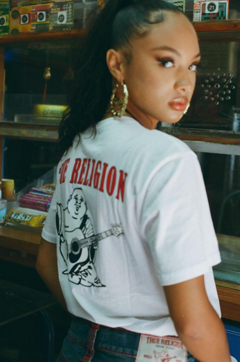 A True Religion T-shirt and jeans.