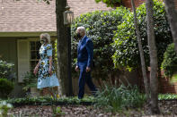 President Joe Biden and first lady Jill Biden leave the home of former President Jimmy Carter during a trip to mark Biden's 100th day in office, Thursday, April 29, 2021, in Plains, Ga. (AP Photo/Evan Vucci)