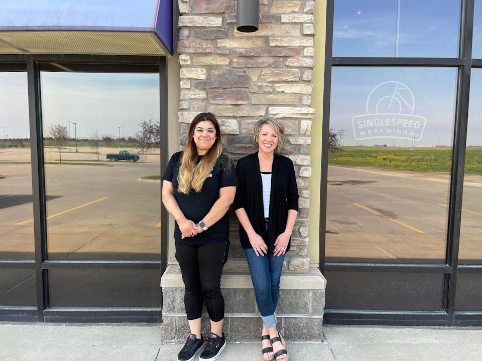 Christine Rodriguez's real estate agent, Tiffany Ehler, right, says she's never experienced such an overheated housing market in Des Moines, Iowa.