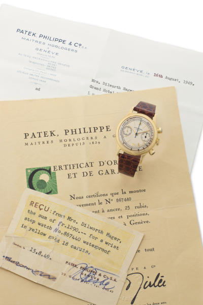 This undated photo provided by Christie's shows the wristwatch believed to have been worn by the neurosurgeon who signed John F. Kennedy's death certificate and an original certificate from the watchmaker. The 18-carat Patek Philippe timepiece is going on the auction block in New York City where it is estimated to bring up to $150,000 at Christie's on Dec. 17. (AP Photo/Christie's)