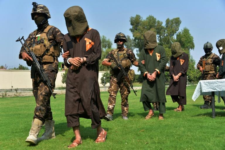 Afghan security personnel escort alleged Islamic State militants during an operation in Jalalabad province in October 2019. Officials say the IS Afghan branch has been defeated in one of the eastern provinces