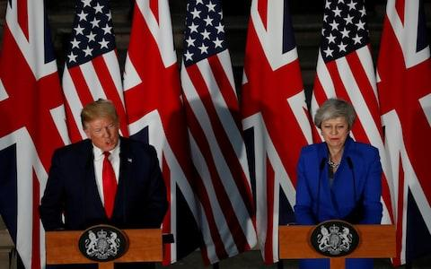 Donald Trump and Britain's Prime Minister - Credit: Carlos Barria/Reuters
