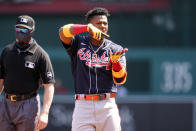 Atlanta Braves' Ronald Acuna Jr. celebrates his double during the first inning in the first baseball game of a doubleheader against the Washington Nationals at Nationals Park, Wednesday, April 7, 2021, in Washington. (AP Photo/Alex Brandon)
