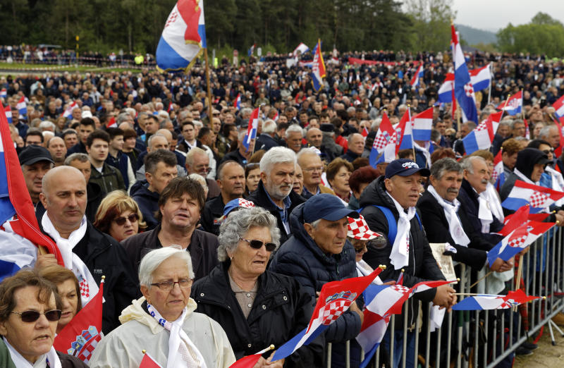 Mourners from Croatia attend a liturgiccal service for victims of the end of WWII events in Bleiburg, southern Austria, Saturday, May 18, 2019. Thousands of Croatian far-right supporters have gathered in a field in southern Austria to commemorate the massacre of pro-Nazi Croats by communists at the end of World War II. (AP Photo/Darko Bandic)