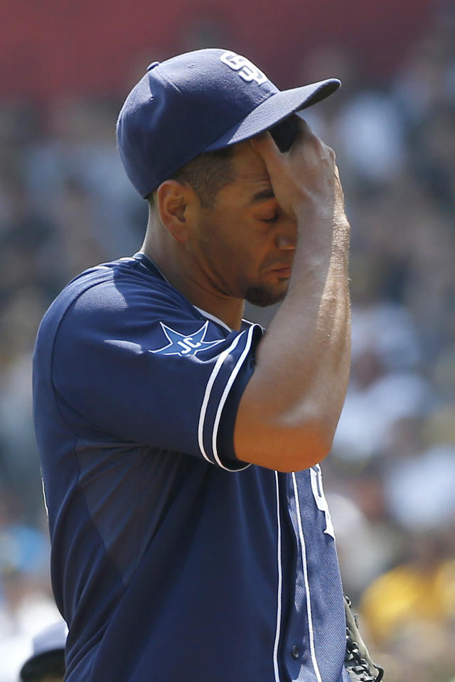 San Diego Padres starting pitcher Tyson Ross wipes his face after giving up a walk to Pittsburgh Pirates' Ike Davis in the first inning of the baseball game on Sunday, Aug. 10, 2014, in Pittsburgh. (AP Photo/Keith Srakocic)