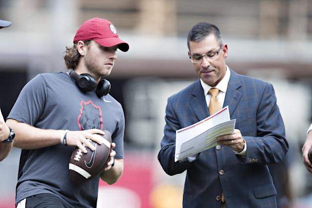 Dan Enos, right, is leaving Michigan before coaching a single game and will instead join Alabama. (Getty)
