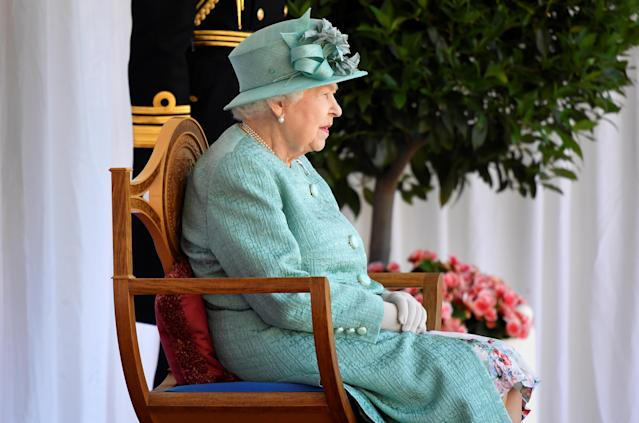 The Queen was spotted smiling as she watched the unusual event. (Getty Images)