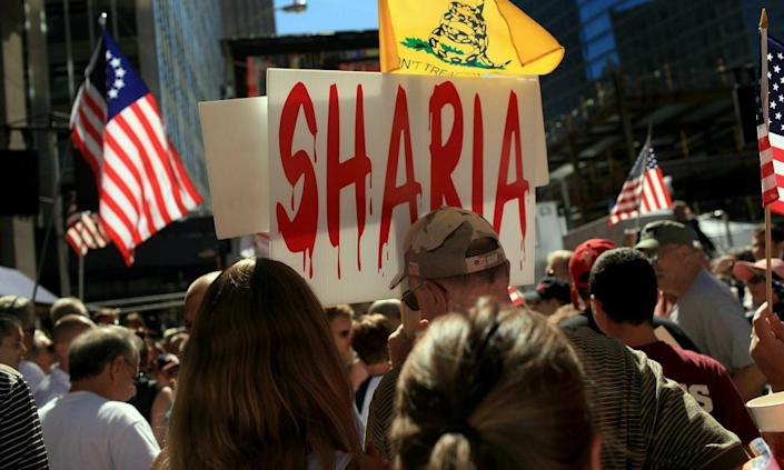"""<span class=""""element-image__caption"""">People demonstrate against allowing an Islamic community center near Ground Zero at a rally in lower Manhattan on 11 September 2010 in New York. The anti-sharia law movement became a force in the wake of the controversy.</span> <span class=""""element-image__credit"""">Photograph: Spencer Platt/Getty Images</span>"""