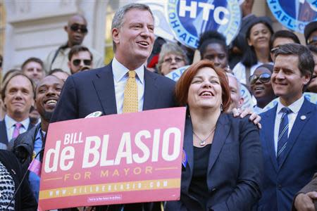 New York City Democratic mayoral nominee de Blasio embraces former mayoral candidate and City Council Speaker Quinn during news conference receiving her endorsement at City Hall in New York