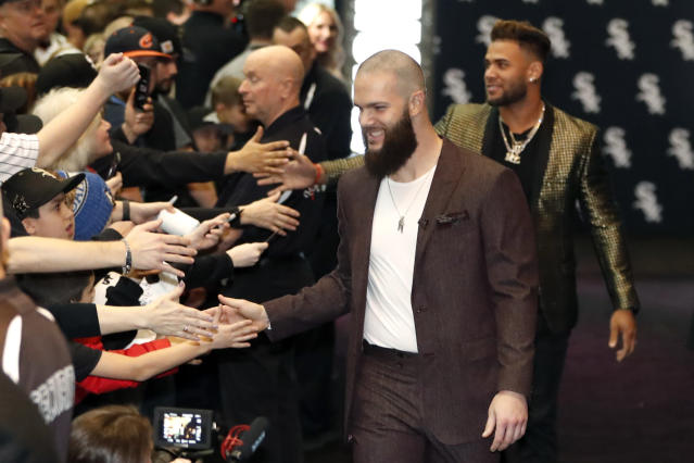 Chicago White Sox's Dallas Keuchel, center, is welcomed by fans after he was introduced during the team's annual fan convention Friday, Jan. 24, 2020, in Chicago. (AP Photo/Charles Rex Arbogast)