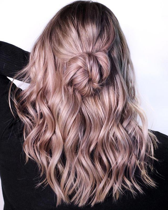 "<p>The coolest addition to any lavender hair color? <a href=""https://www.cosmopolitan.com/style-beauty/beauty/how-to/a8624/how-to-get-beachy-waves/"" rel=""nofollow noopener"" target=""_blank"" data-ylk=""slk:Beachy waves"" class=""link rapid-noclick-resp""><strong>B</strong><strong>eachy waves</strong></a><strong> and a half-up bun</strong>. To recreate these waves, wrap once-inch sections of hair around a <a href=""https://www.cosmopolitan.com/style-beauty/beauty/g13107292/best-curling-iron-wand-tools/"" rel=""nofollow noopener"" target=""_blank"" data-ylk=""slk:curling wand"" class=""link rapid-noclick-resp"">curling wand</a>, tugging on the ends to loosen each curl before it cools.</p><p><a href=""https://www.instagram.com/p/CBTQCrKHpu4/"" rel=""nofollow noopener"" target=""_blank"" data-ylk=""slk:See the original post on Instagram"" class=""link rapid-noclick-resp"">See the original post on Instagram</a></p>"