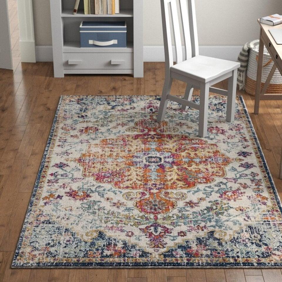 "<br><br><strong>Mistana</strong> Hillsby Oriental Area Rug, $, available at <a href=""https://go.skimresources.com/?id=30283X879131&url=https%3A%2F%2Fwww.wayfair.com%2Frugs%2Fpdp%2Fmistana-hillsby-oriental-blueorange-area-rug-mtna3186.html"" rel=""nofollow noopener"" target=""_blank"" data-ylk=""slk:Wayfair"" class=""link rapid-noclick-resp"">Wayfair</a>"