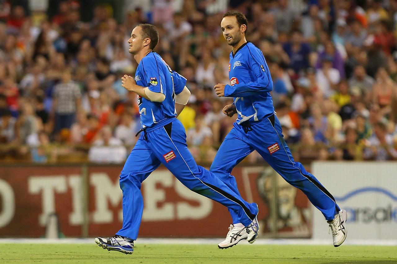 PERTH, AUSTRALIA - DECEMBER 09:  Michael Klinger and Nathan Lyon of the Strikers run to celebrate the dismissal of Shaun Marsh of the Scorchers with Johan Botha during the Big Bash League match between the Perth Scorchers and Adelaide Strikers at WACA on December 9, 2012 in Perth, Australia.  (Photo by Paul Kane/Getty Images)