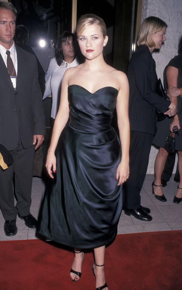 <p>The young starlet kept in classic in a strapless draped little black dress. </p>