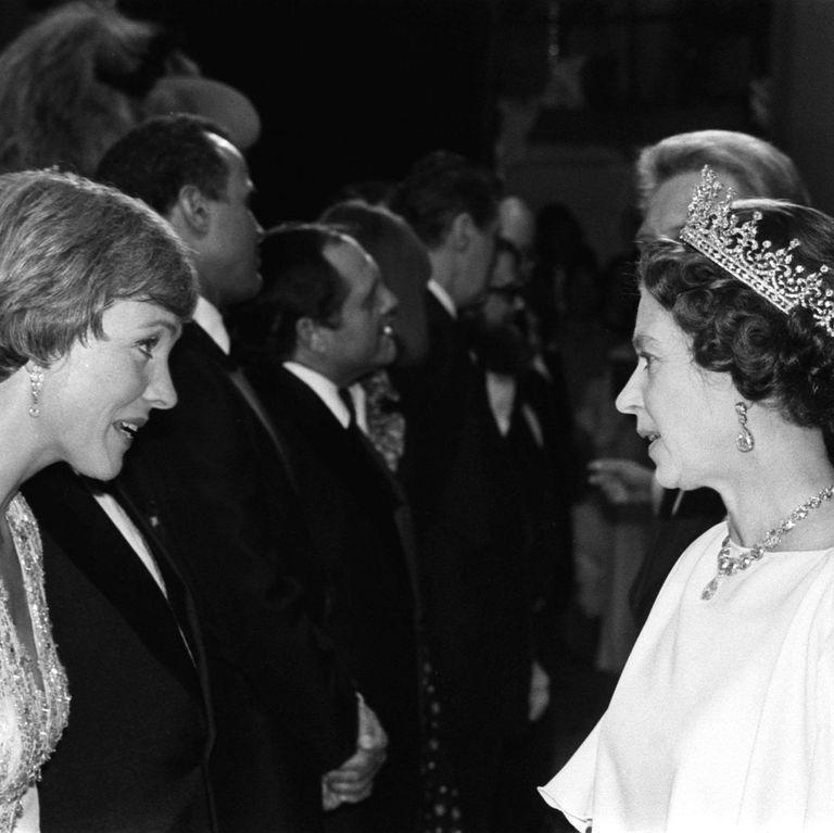 <p>Andrews speaks with Queen Elizabeth II while attending the Silver Jubilee Royal Variety Gala. The Queen later awarded Andrews with the title of Dame in 2002. <br></p>