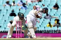 India's Rishabh Pant hits out as India reached lunch at 206-3 chasing 407 to win the third Test against Australia