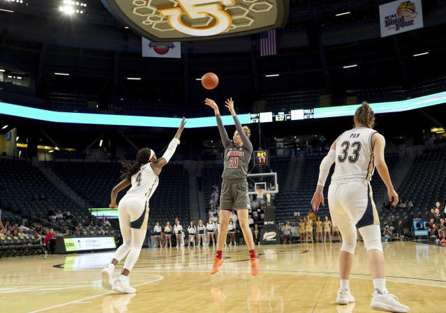 Louisville forward Kylee Shook (21) shoots over Georgia Tech forward Anne Francoise Diouf and guard Francesca Pan during the first half of an NCAA college basketball game Thursday, Feb. 20, 2020, in Atlanta, Ga(AP Photo/Tami Chappell)
