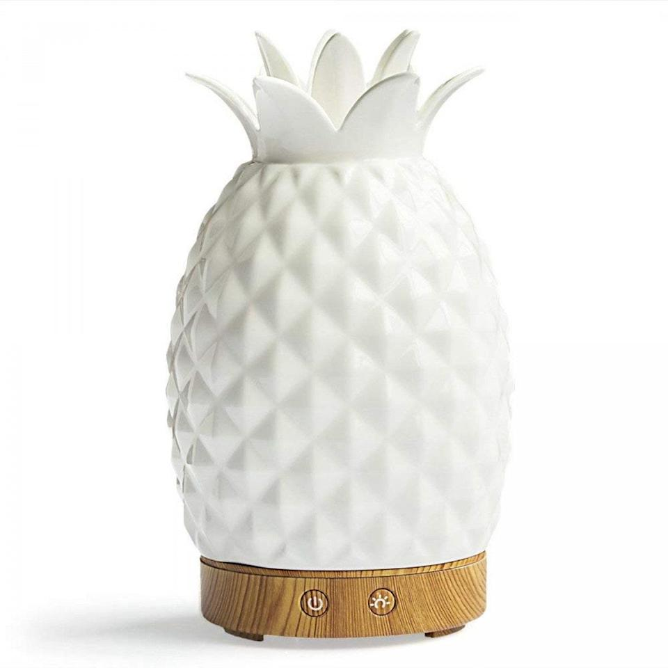 """<p>Round Rich's Pineapple Essential Oil Diffuser is cool in more ways than one. In addition to its adorable design that fits right into any decor style, it serves as both an essential oil diffuser and a humidifier, adding healthy moisture and elegant aromatherapy into the atmosphere. Plus, it's <em>literally</em> cool — the mist emitted isn't heated, so it's ideal for year-round use.</p> <p><strong>$35</strong> (<a href=""""https://shop-links.co/1712737001481314235"""" rel=""""nofollow noopener"""" target=""""_blank"""" data-ylk=""""slk:Shop Now"""" class=""""link rapid-noclick-resp"""">Shop Now</a>)</p>"""