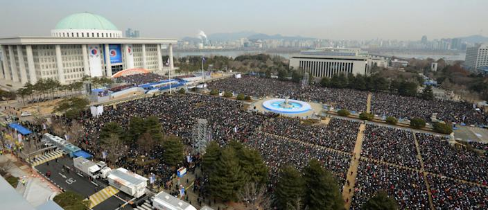 Thousands attend the inaugural ceremony of South Korea's new President Park Geun-hye at the National Assembly in Seoul, South Korea, Monday, Feb. 25, 2013. Park took office as South Korea's first female president Monday, returning to the presidential mansion she had known as the daughter of a dictator, and where she will respond to volatile North Korea, which tested a nuclear device two weeks ago. (AP Photo/Yonhap) KOREA OUT