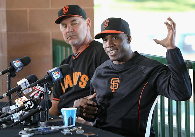 SCOTTSDALE, AZ - MARCH 10: Barry Bonds (R) of the San Francisco Giants speaks alongside manager Bruce Bochy during a press conference about his return to the organization as a special hitting coach for one week of Spring Training at Scottsdale Stadium on March 10, 2014 in Scottsdale, Arizona. (Photo by Christian Petersen/Getty Images)