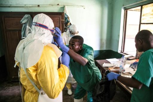 Health workers don protective gear before examining suspected Ebola patients at Bikoro hospital in DR Congo's Equateur province