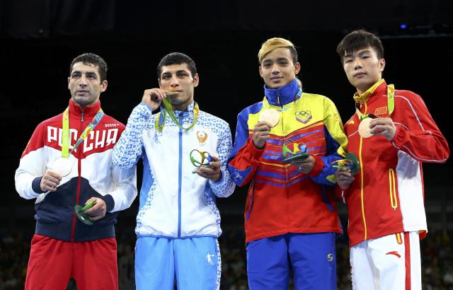 2016 Rio Olympics - Boxing - Victory Ceremony - Men's Fly (52kg) Victory Ceremony - Riocentro - Pavilion 6 - Rio de Janeiro, Brazil - 21/08/2016. (From L) Silver medallist Misha Aloian (RUS) of Russia, gold medallist Shakhobidin Zoirov (UZB) of Uzbekistan and bronze medallists Yoel Finol (VEN) of Venezuela and Hu Jianguan (CHN) of China pose with their medals. REUTERS/Peter Cziborra FOR EDITORIAL USE ONLY. NOT FOR SALE FOR MARKETING OR ADVERTISING CAMPAIGNS.