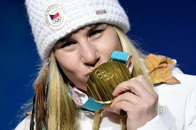"Snowboard star Ester Ledecka's ""bonus"" gold medal in last weekend's Olympic super-G ruffled feathers in the world of alpine skiing, her ski coach said Tuesday (AFP Photo/JAVIER SORIANO)"