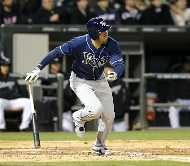 Tampa Bay Rays' David DeJesus watches his RBI double off Chicago White Sox starting pitcher Andre Rienzo, scoring Wil Myers, during the fourth inning of a baseball game Monday, April 28, 2014, in Chicago. (AP Photo/Charles Rex Arbogast)