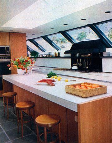 <p>By now, the island is a mainstay in a kitchen. But in the '80s, like shoulder pads and hair, the island gets <em>huge</em>. Part of this was due to the natural evolution of the kitchen as a social space. The other reason? Pure status symbol.</p>