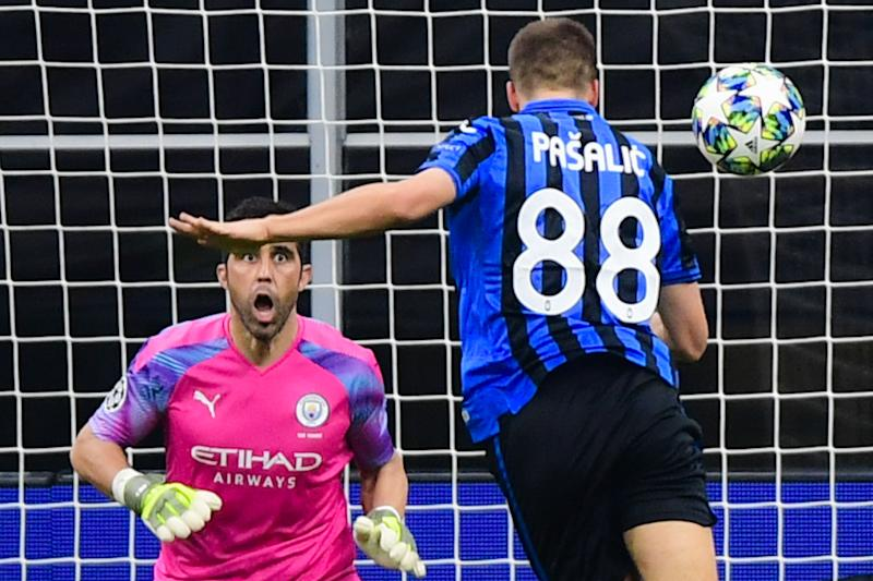 Atalanta's Croatian midfielder Mario Pasalic (R) scores a header past Manchester City's Brazilian goalkeeper Ederson to equalize during the UEFA Champions League Group C football match Atalanta Bergamo vs Manchester City on November 6, 2019 at the San Siro stadium in Milan. (Photo by Miguel MEDINA / AFP) (Photo by MIGUEL MEDINA/AFP via Getty Images)