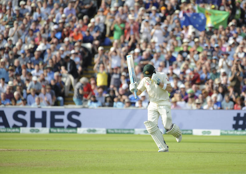 Australia's Steven Smith runs his way to a century during day one of the first Ashes Test cricket match between England and Australia at Edgbaston in Birmingham, England, Thursday Aug. 1, 2019. (AP Photo/Rui Vieira)