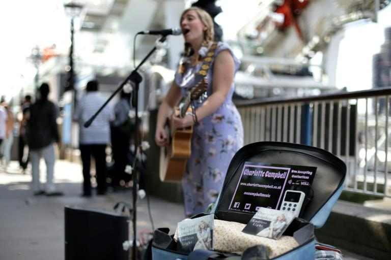 London busker Charlotte Campbell is one of the first performers to use a contactless card reader
