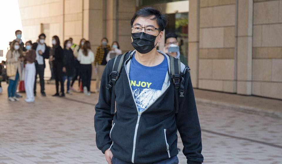 Chow Tak-ming, the father of late university student Alex Chow, leaves West Kowloon Court on Friday. Photo: Brian Wong