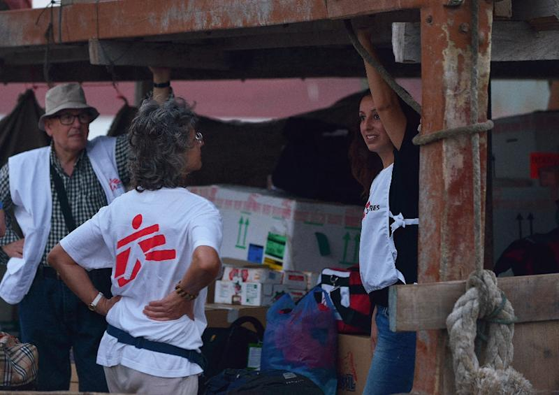 Medical experts, including members of Doctors Without Borders (MSF), stand on the deck a boat commissioned by MSF to deliver surgical and other medical equipment across the Gulf of Aden to Yemen