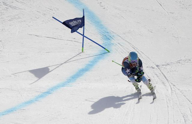 Gold medal winner, United States' Ted Ligety skis in the second run of the men's giant slalom at the Sochi 2014 Winter Olympics, Wednesday, Feb. 19, 2014, in Krasnaya Polyana, Russia. (AP Photo/Charlie Riedel)